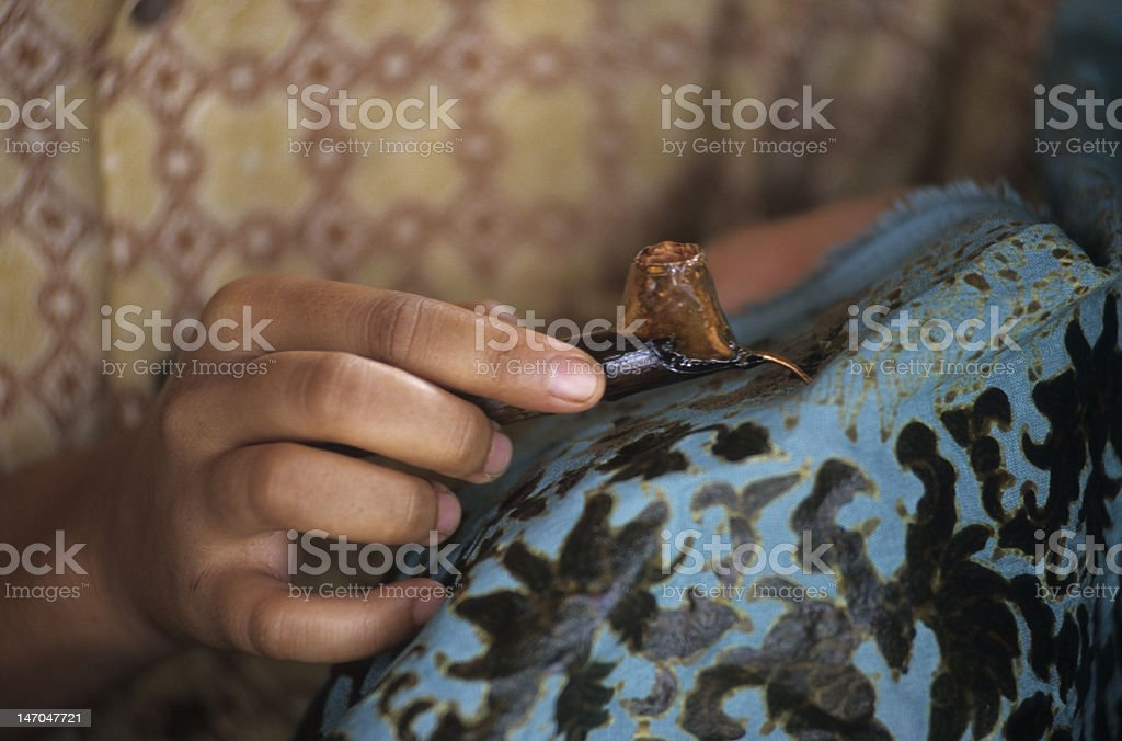 Batik making, Indonesia. Hand-drawn Textile, Kain Tulis. stock photo