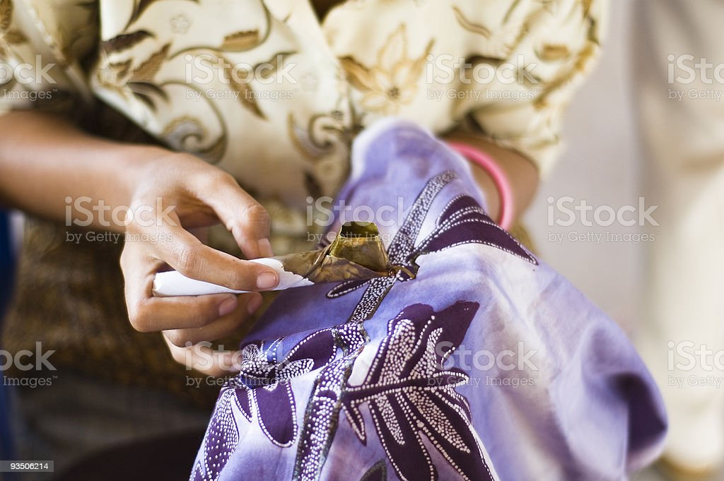 Batik painting  with wax on purple fabric stock photo