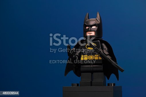 Tambov, Russian Federation - June 08, 2015: LEGO Batman minifigure with batarangs on blue background. LEGO DC Comics Super Heroes series. Studio shot.