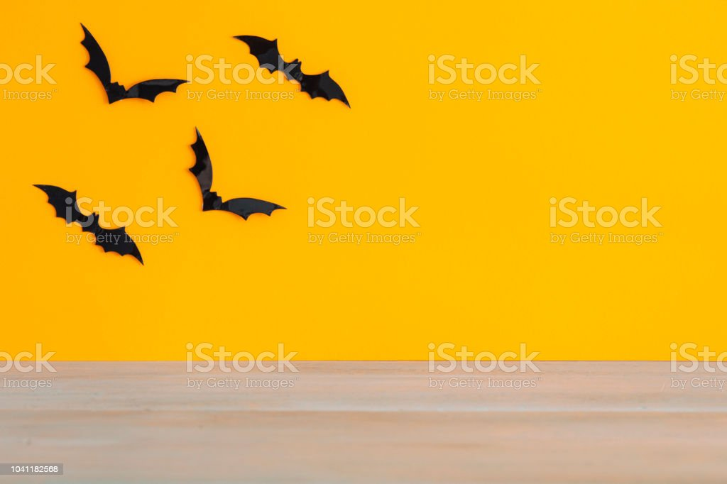 Bats with an orange background. Halloween concept. stock photo
