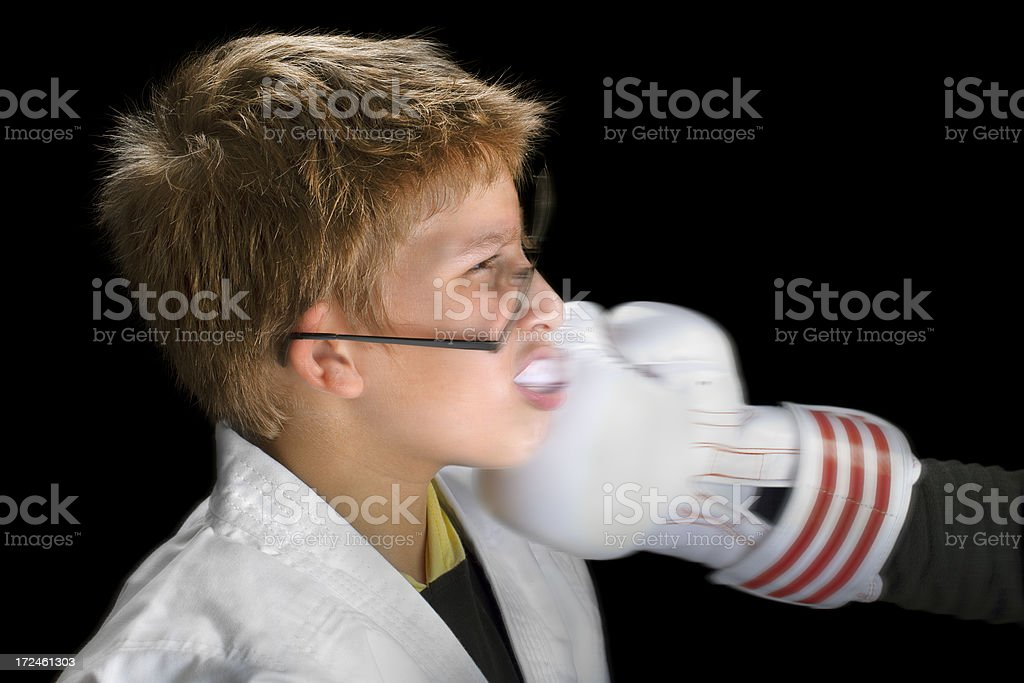 Battered boy give  hard punch hit in training royalty-free stock photo