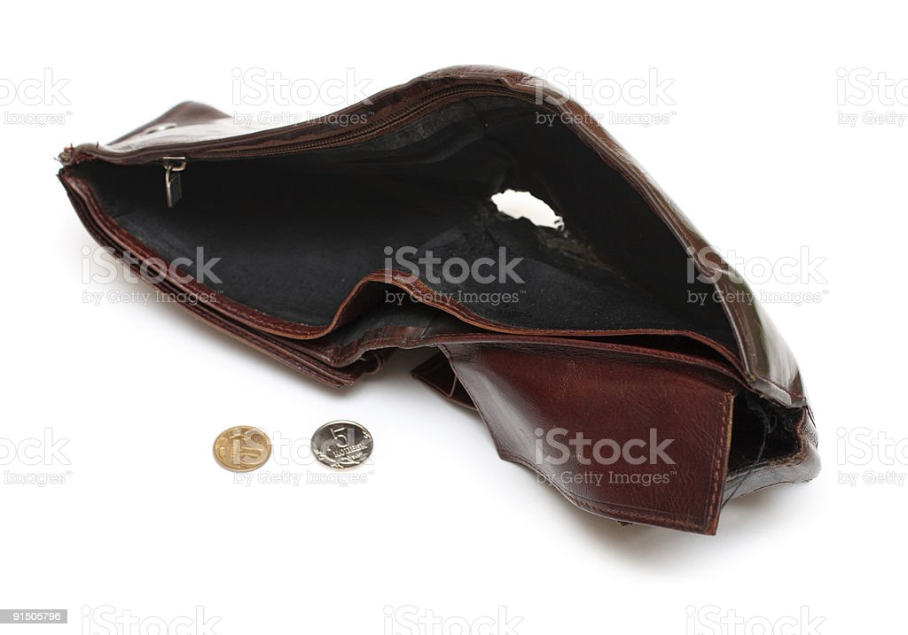 battered empty purse with tear stock photo