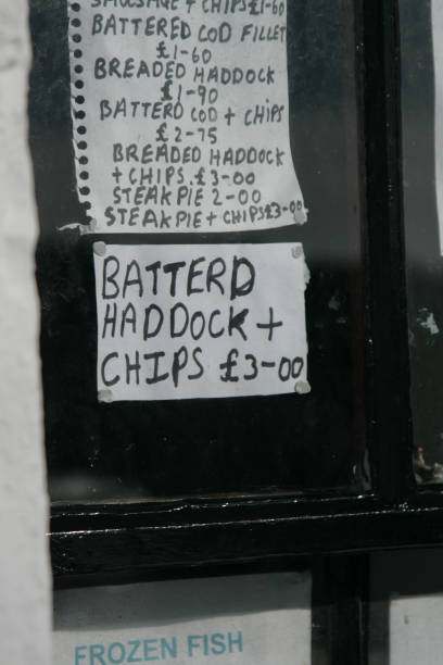Battered haddock and chips misspelled handwritten sign, Dumfries stock photo
