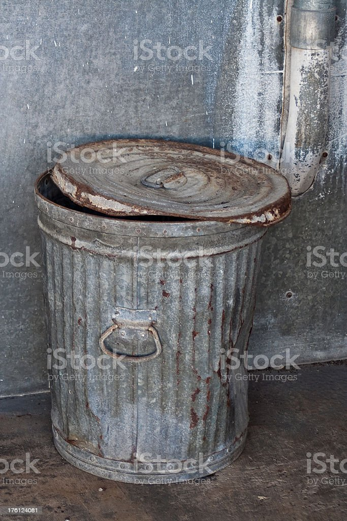 Battered Old Trash Can stock photo