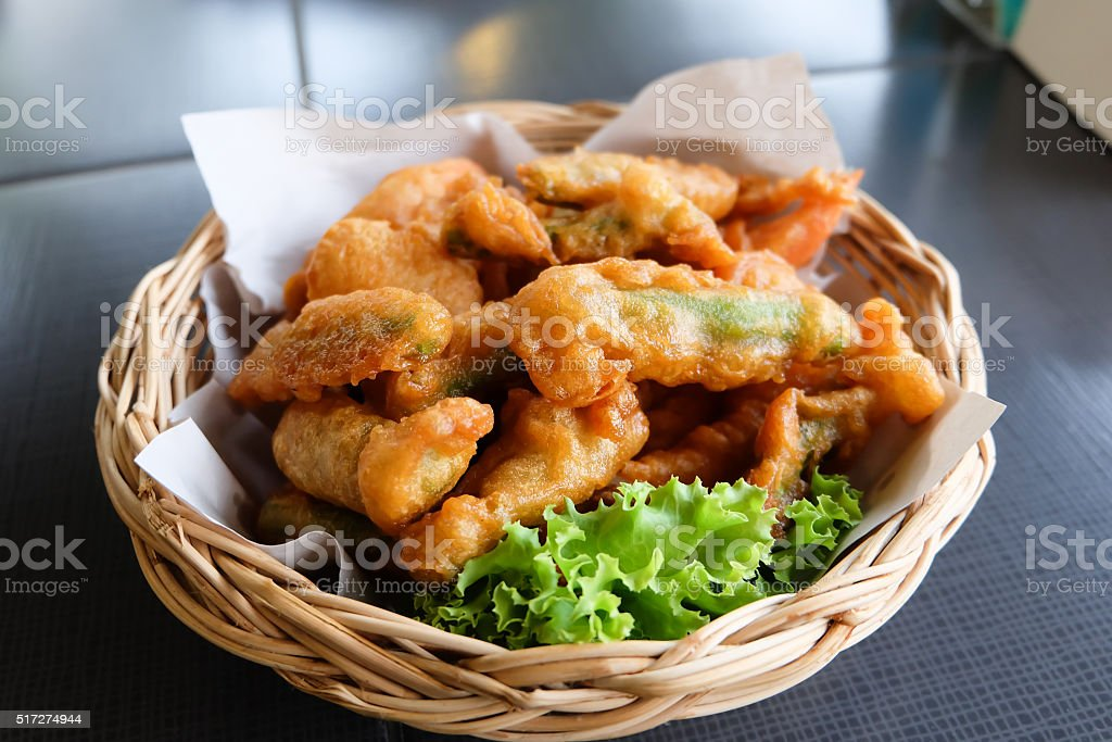 batter-fried prawns and vegetables stock photo