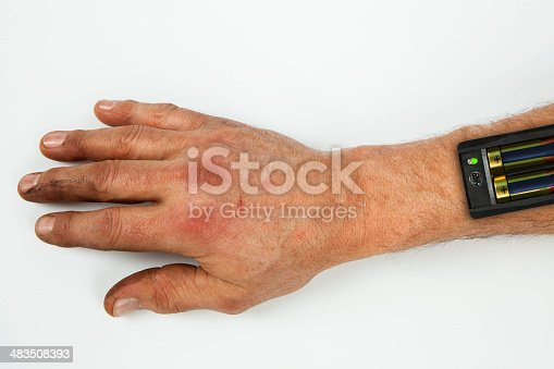 istock Batteries inserted into a hand. Creative 483508393