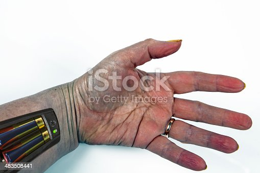 istock Batteries inserted into a hand. Creative 483508441