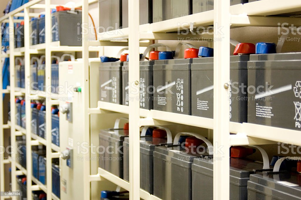 UPS batteries on rows of shelves stock photo