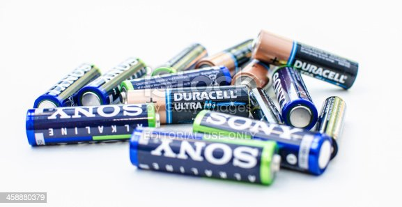 Derby, England, United Kingdom - August 18, 2013: A stack of Sony and Duracell batteries isolated on white. Photographed in a studio setting.