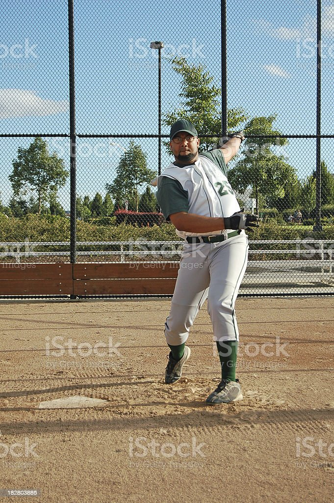 Batter's Follow Through royalty-free stock photo