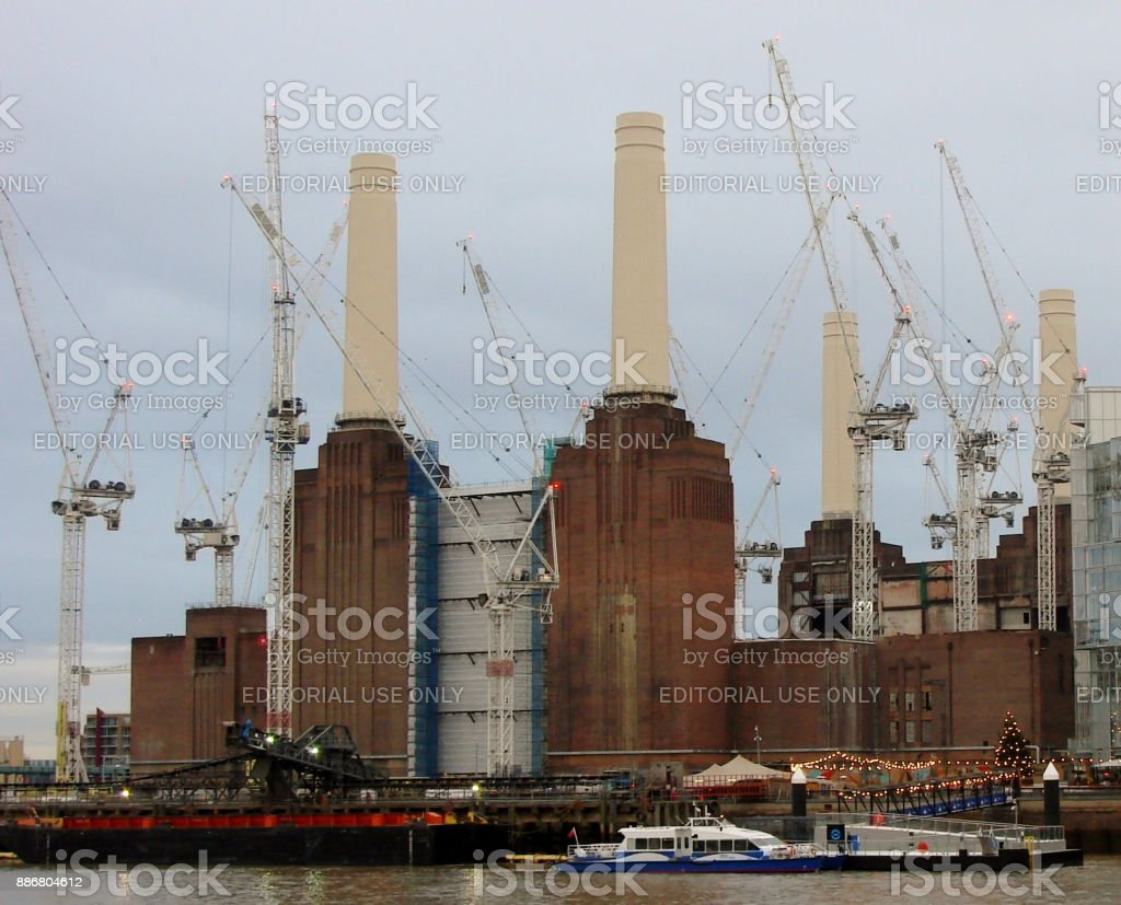 Battersea Power Station with cranes and new river boat pontoon stock photo