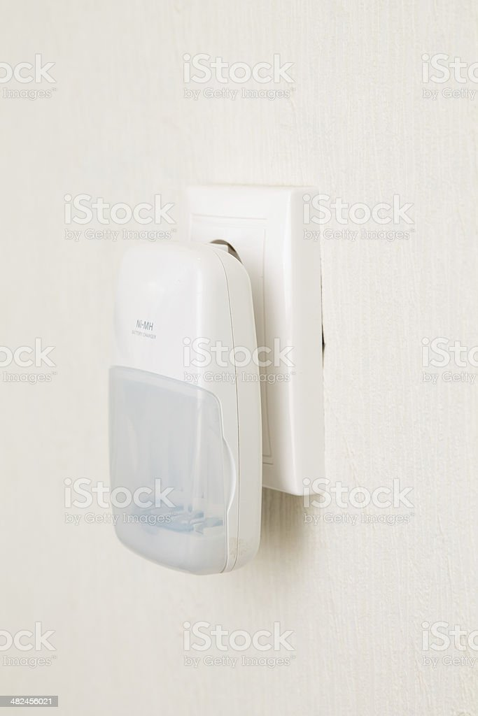 Battery Charger in the socket royalty-free stock photo