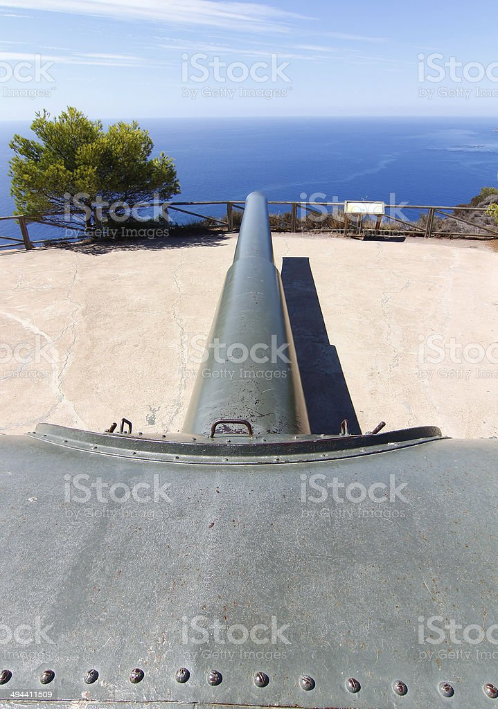 battery of coastal artillery of a powerful cannon in impressive stock photo