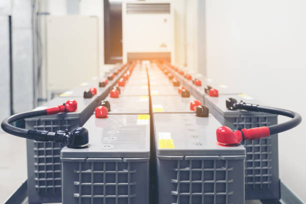 Battery pack in battery room in power plant for supply electricity in plant during shutdown phase, Rows of batteries in industrial backup power system. stock photo
