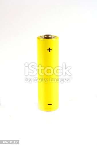 Yellow AA battery on a white