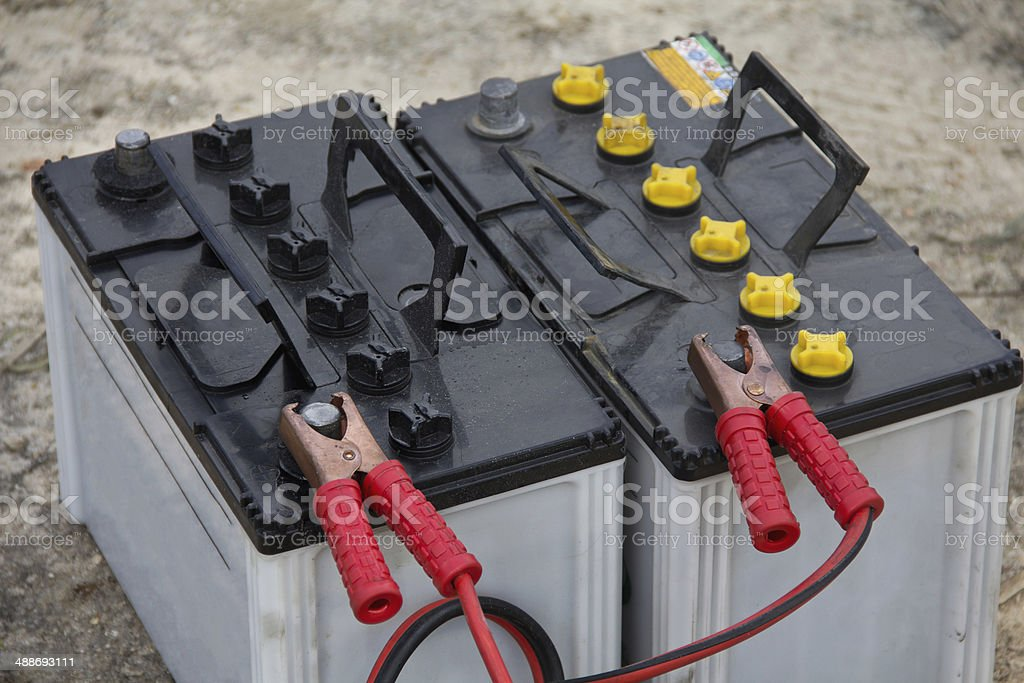 battery with clamps on the contacts stock photo