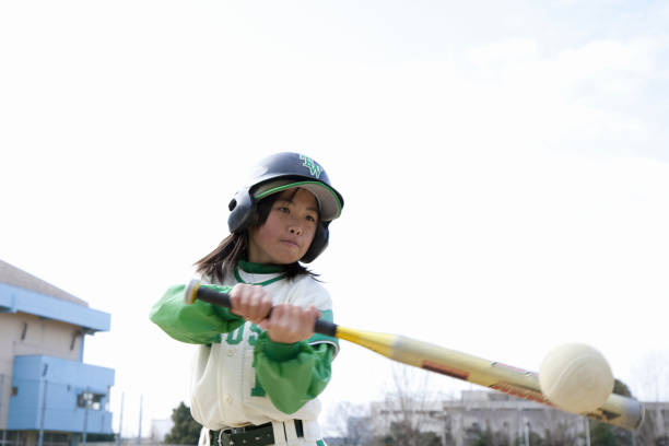 Batting baseball girls Batting baseball girls baseball sport stock pictures, royalty-free photos & images