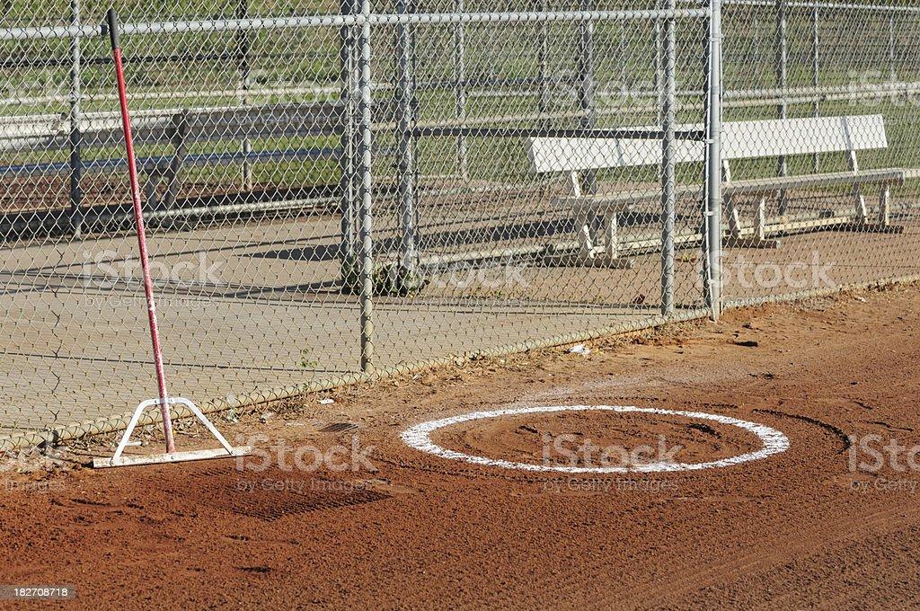 Batting circle and dugout on baseball field stock photo