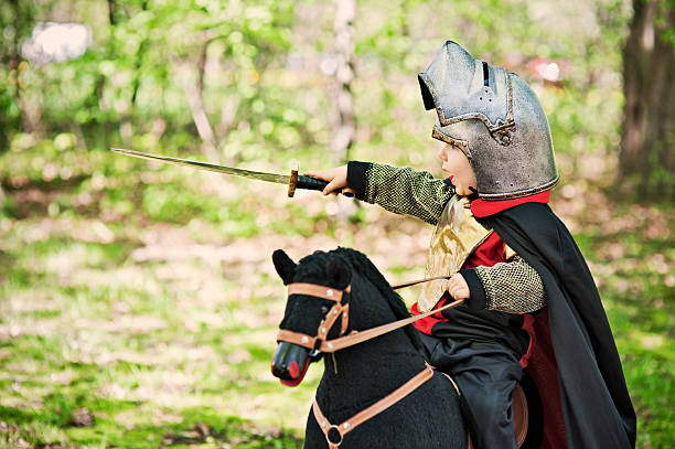 battle in the wood - knight on horse stock photos and pictures