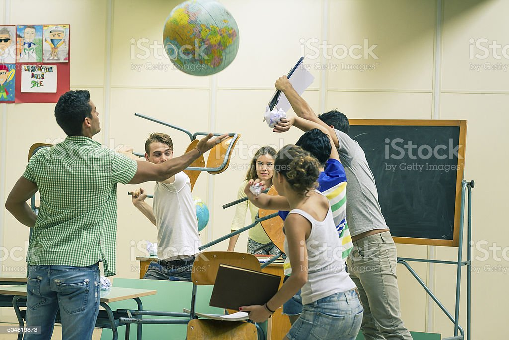 Battle of students in classroom stock photo
