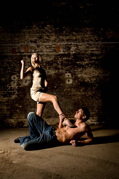 battle of the sexes - man dominating woman stock photos and pictures