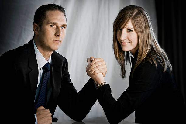battle of the sexes - gender stereotypes stock photos and pictures