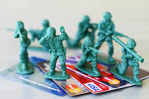 Battle over Budget. Toy soldiers protect credit cards, spending. stock photo