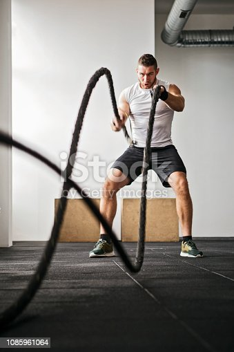 strength training in a gym with rope