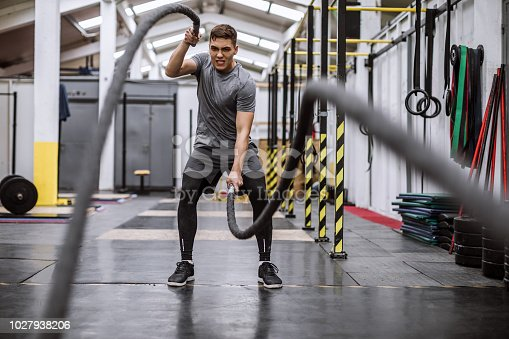 Difficult Rope Cardiovascular Exercise In Indoor Gym On Cross Training