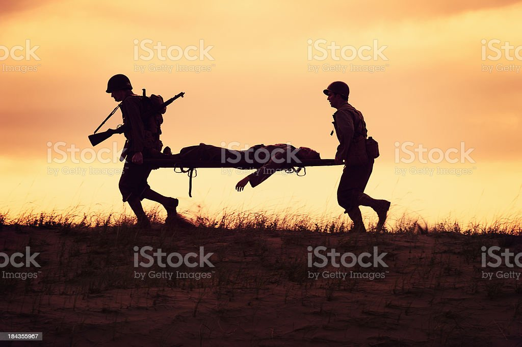 WWII  Battlefield Casuality Evacuation by Unit Medics stock photo