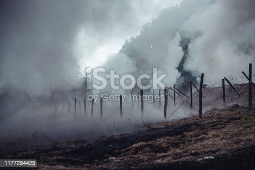 Battlefield covered with poison gas, barbed wire and trenches.