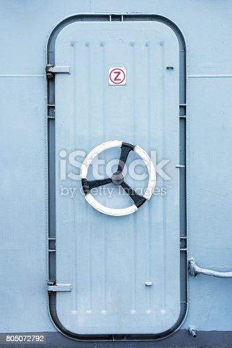 istock Battleship iron door with steering wheel lock background 805072792