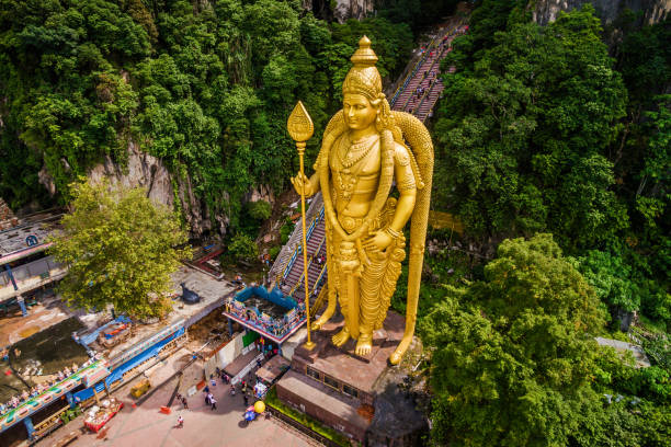 Batu Caves, Kuala Lumpur, Malaysia, Aerial View of Lord Murugan Statue and Entrance to the Famous Cave Temples stock photo