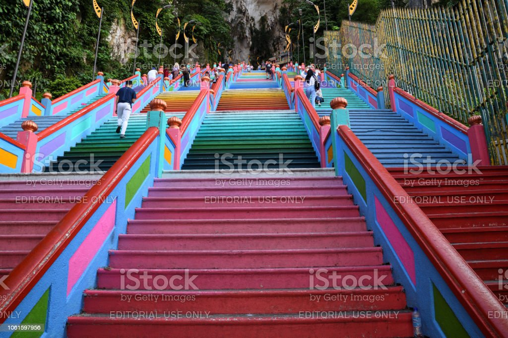 Batu Caves Kuala Lumpur, Malaysia - October 25, 2018. The 272 colourful steps leading up to the Batu Caves Temple which is a popular tourist attraction. Site of a Hindu temple and shrine, Batu Caves attracts thousands of worshippers and tourists, especially during the annual Hindu festival, Thaipusam. Architecture Stock Photo