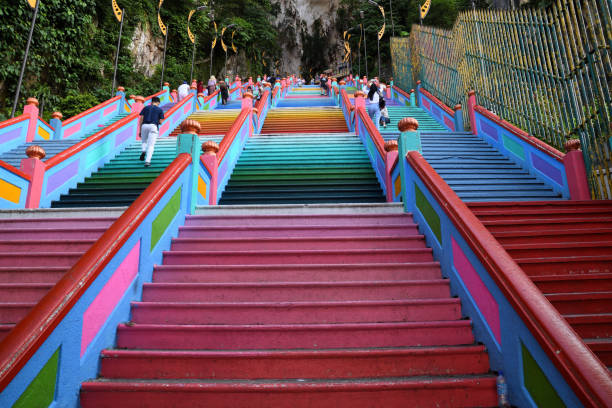Batu Caves Kuala Lumpur, Malaysia - October 25, 2018. The 272 colourful steps leading up to the Batu Caves Temple which is a popular tourist attraction. Site of a Hindu temple and shrine, Batu Caves attracts thousands of worshippers and tourists, especially during the annual Hindu festival, Thaipusam. kuala lumpur batu caves stock pictures, royalty-free photos & images