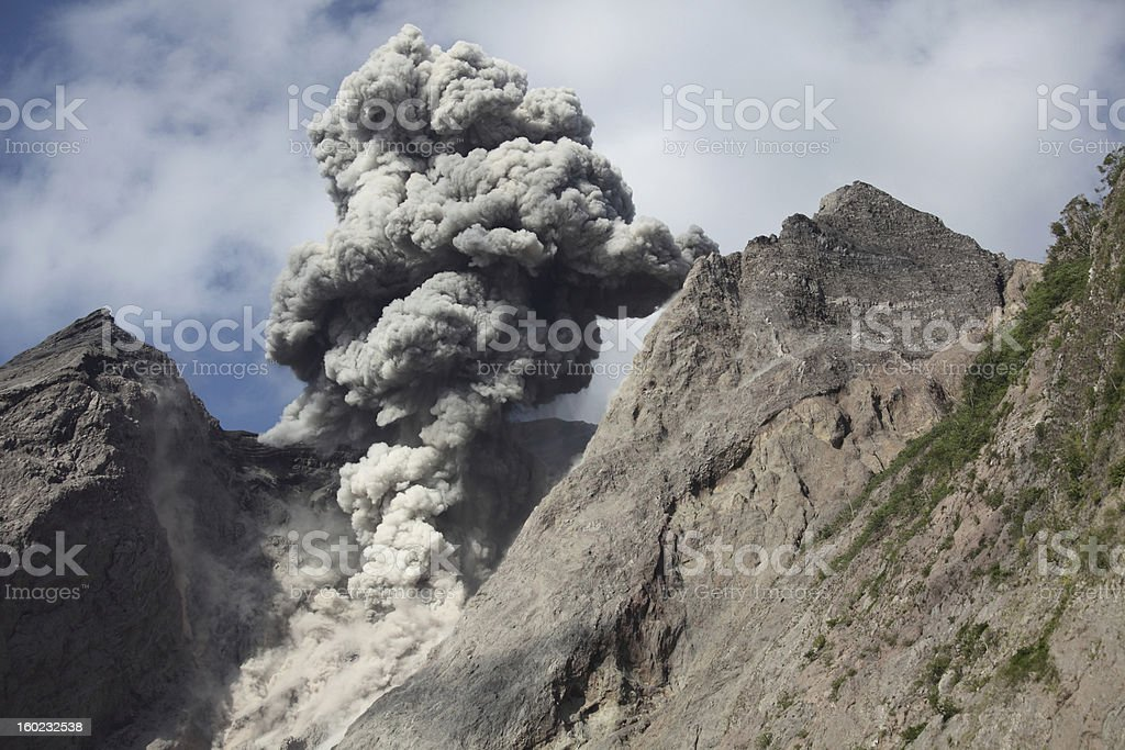 Batu Tara volcano erupting ash cloud stock photo
