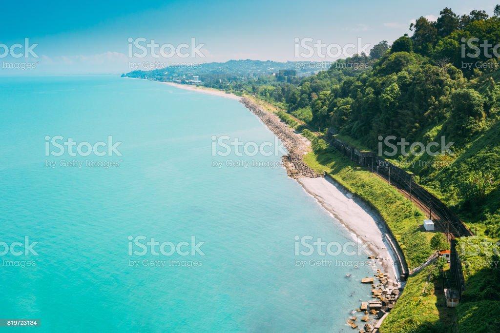 Batumi, Adjara Georgia. Beautiful Summer View From Botanical Garden Of Sea Bay And Railroad On Coast. The Lush Green Vegetation Of Summer. Sunny Day. stock photo