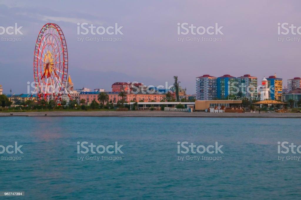 Batumi, Adjara, Georgia. View from the sea on resort town at evening - Foto stock royalty-free di Acqua