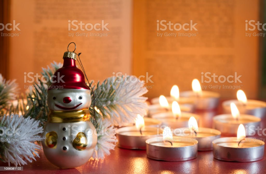 Bauble tree bible and candle abstract christmas background in night stock photo