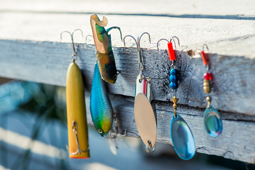 baubles and hooks for fishing close-up on a wooden pier