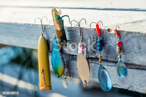 istock baubles and hooks for fishing close-up on a wooden pier 943649610