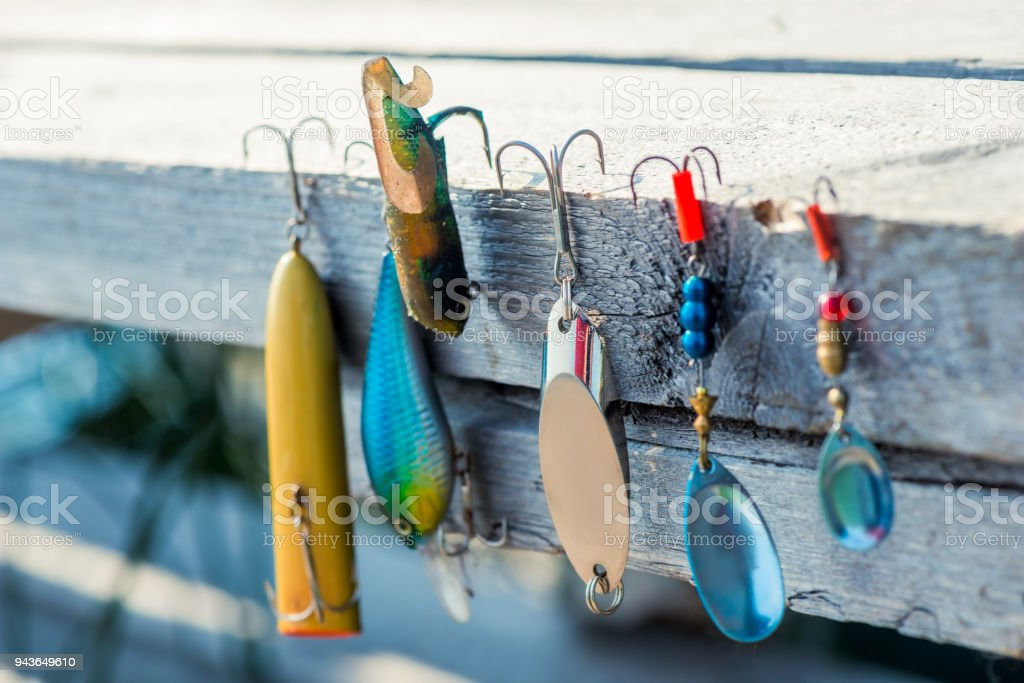 baubles and hooks for fishing close-up on a wooden pier stock photo
