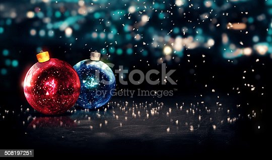 istock Baubles Christmas Night Bokeh Beautiful 3D Background Red Blue 508197251