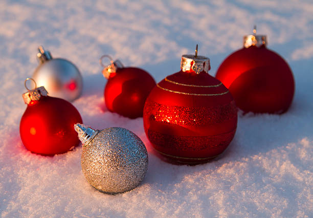 Baubles in snow stock photo