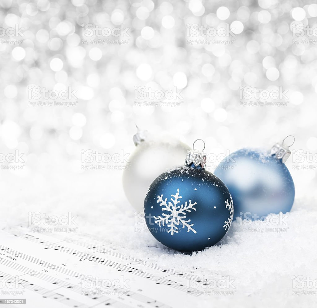 Baubles on sheet notes stock photo