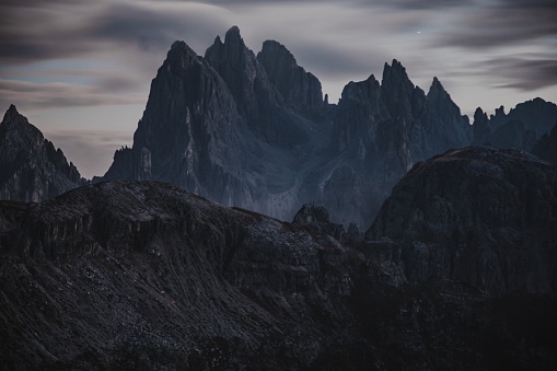 Fantastic night mountain landscape Dolomiten mountains view with moon lights of the Cadin di San Lucano peak di Misurina group Belluno district,Auronzo di Cadore in the Dolomites mountain range in South Tirol, Dolomites, Northern Italy. Popular travel and hiking Destination in the world.