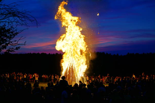 Bavaria, Customs and tradition. Johannisfeuer or Sonnwendfeuer where  Straw dolls are burned at Saint John's Eve. Bavaria, Customs and tradition. Johannisfeuer or Sonnwendfeuer where  Straw dolls are burned at Saint John's Eve. bonfire stock pictures, royalty-free photos & images