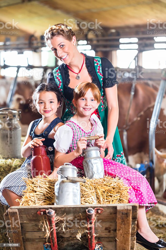 Bavaria family driving pushcard in cow barn stock photo