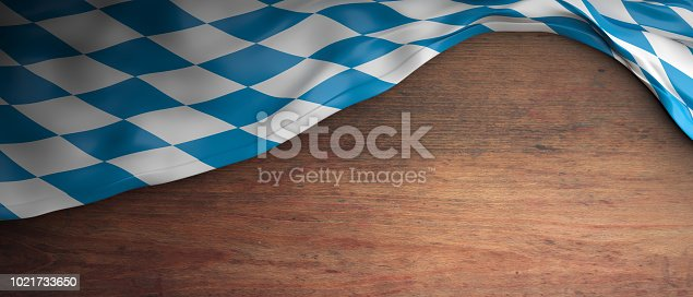 istock Bavaria flag for Oktoberfest. Wooden background with copyspace. 3d illustration 1021733650