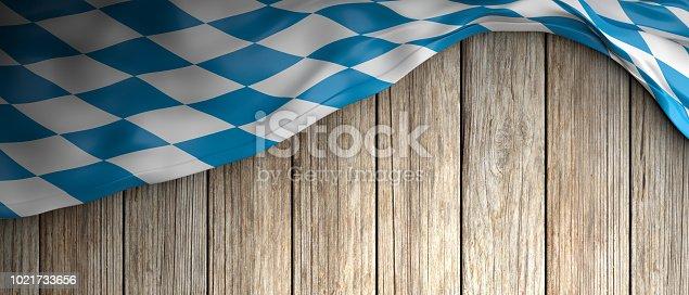 istock Bavaria flag for Oktoberfest. Wooden background with copyspace. 3d illustration 1021733656